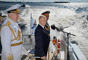 Commander-in-Chief of the Russian Navy Admiral Nikolai Yevmenov, Russian President Vladimir Putin, center, and Defense Minister Sergei Shoigu inspect warships in the Kronstadt roadstead aboard the Raptor boat ahead of a military parade on Russian Navy Day. St. Peterburg, Russia, July 26, 2020.
