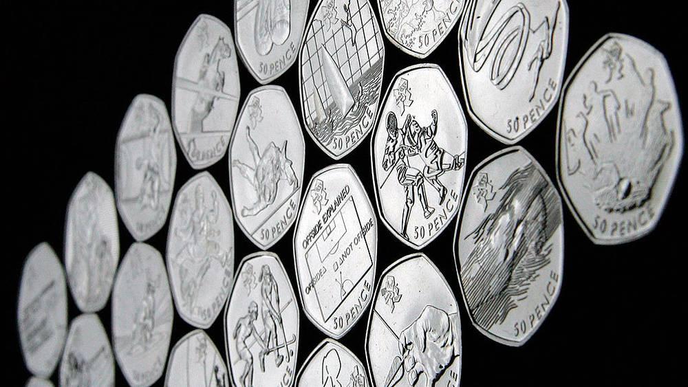 Коллекция памятных монет, выпущенных Королевским монетным двором Великобритании к летним Олимпийским играм 2012 в Лондоне. EPA/THE ROYAL MINT