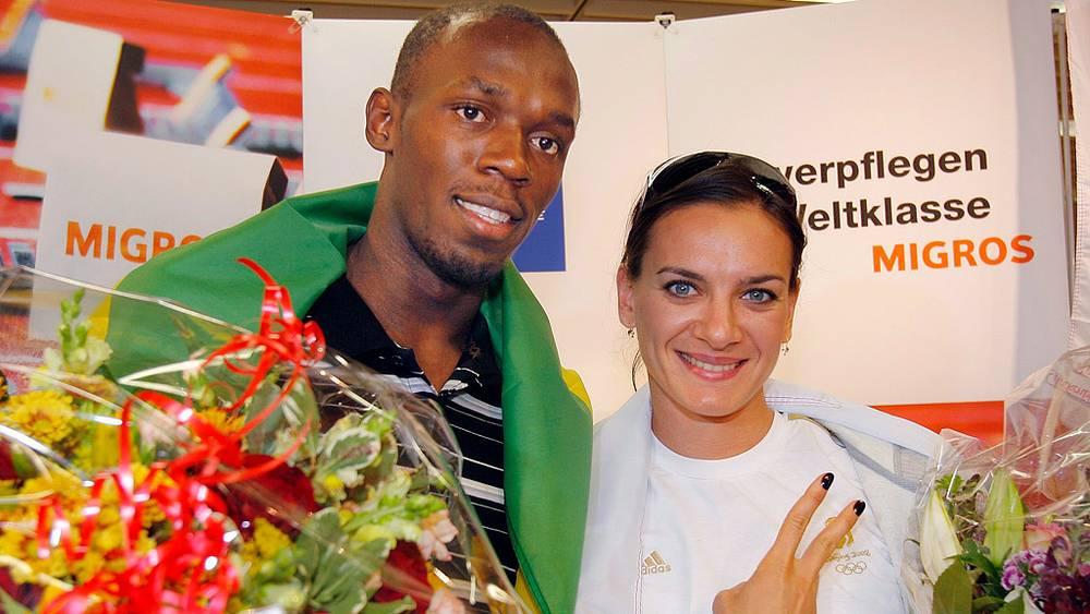 Елена Исимбаева и ямайский легкоатлет Усейн Болт. 2008 год