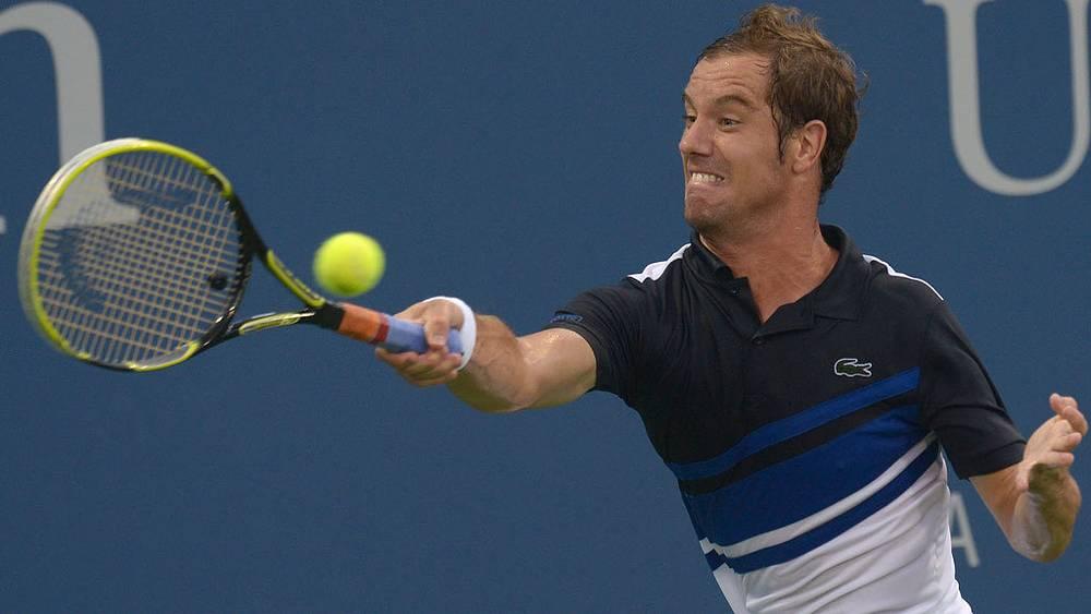 Французский теннисист Ришар Гаске в матче против канадца Милоша Раонича в четвертом круге. Фото EPA/JUSTIN LANE