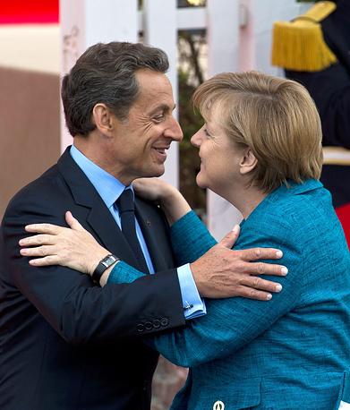 Николя Саркози и канцлер Германии Ангела Меркель во время саммита G8 в Довиле. Франция, 2011 год