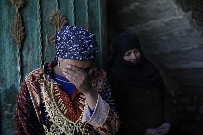 """Сообщалось, что за похищением стояли активисты ультрарадикальной салафитской группировки """"Ансар аш-шариа"""" (""""Сторонники шариата""""). На фото: родственники погибших в провинции Эль-Минья"""