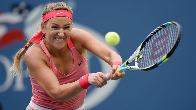 Белорусская теннисистка Виктория Азаренко в матче против сербки Аны Иванович в четвертом раунде. Фото EPA/JOHN G. MABANGLO