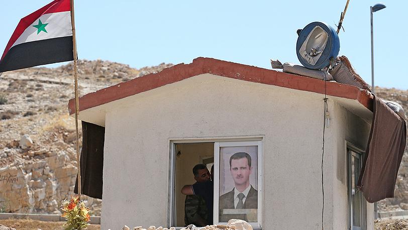 На территории поста сирийской армии вблизи города Маалюля к северо-востоку от Дамаска. Фото ИТАР-ТАСС/ Михаил Почуев