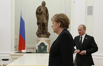 Канцлер Германии Ангела Меркель и президент России Владимир Путин и во время двусторонней встречи в Кремле