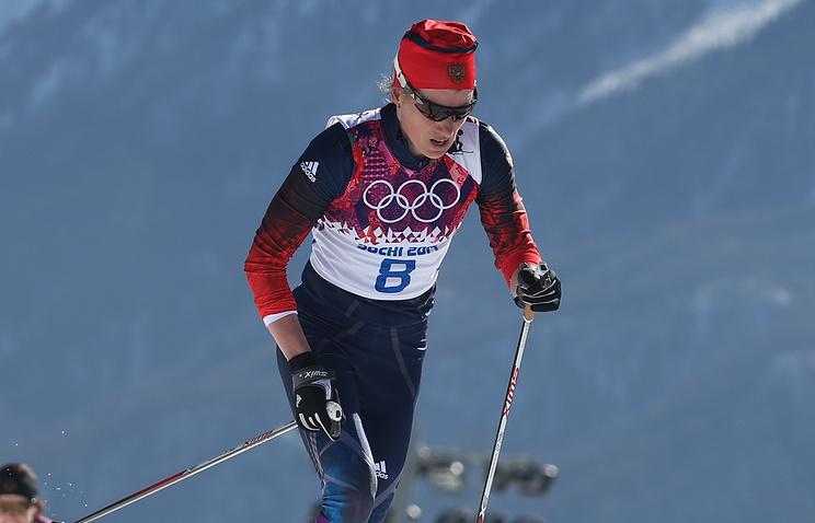 Юлия Чекалева на дистанции скиатлона в соревнованиях по лыжным гонкам среди женщин на XXII зимних Олимпийских играх