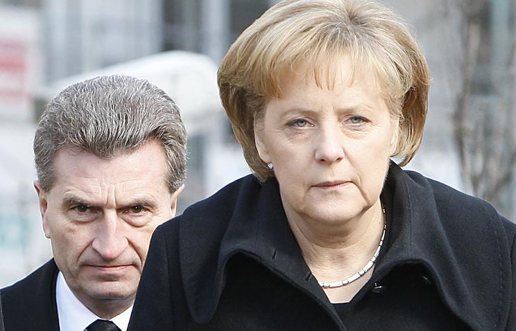 Гюнтер Эттингер и Ангела Меркель