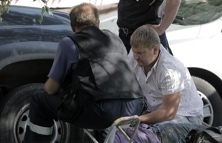 Сотрудники полиции на месте трагедии. 2012 год