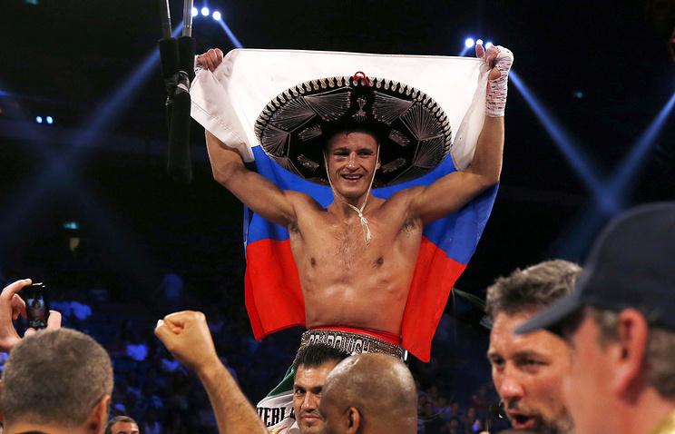 Евгений Градович после победы над Александром Мискирчаном из Бельгии в Макао. 31 мая 2014 года