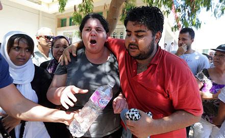 Родственники Мохамеда Брахми. Фото EPA/ИТАР-ТАСС