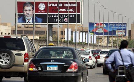 Предвыборный плакат с изображением Мухаммеда Мурси. Фото ЕРА/ИТАР-ТАСС